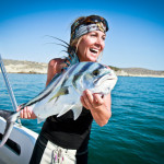 Kim Singer with a Rooster Fish