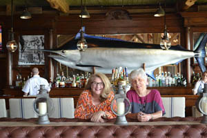 Christy and JoAnn in front of the 1,358-pound black marlin caught by Jack Nicklaus off the Great Barrier Reef.