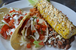 Dos Equis-battered cod tacos with Mexico City street corn-on-the-cob.