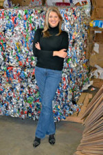 Melinda Caldwell with bales of recyclables at Baxter Day Service Center
