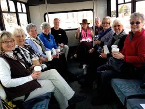 Brenda Bowers, Barbara Williams, Sandy Olson, Brenda Ferebee, Terry Ray, Carolyn Gill, Marydell Ponce, Joyce Holsted, T.J. Hill and Susan Svatek on the bus.