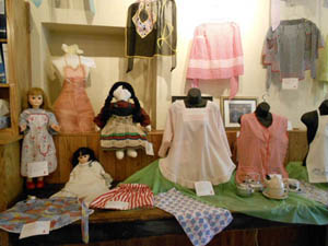 A collection of 100 aprons on display, loaned by collector Barbara Gordy of Lawson