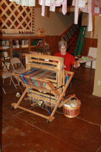 Shirley Dossett weaving at 4th Friday event.