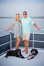 Katie and Sean Combs and their two dogs on the houseboat.