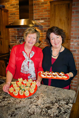 Joan Michalek and Estella with their dishes, Wonton Stuffed Shells and Roasted Cranberry and Orange Crostini.