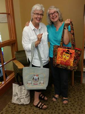 Jan Thomas and Barbara Carlson with literacy bags.