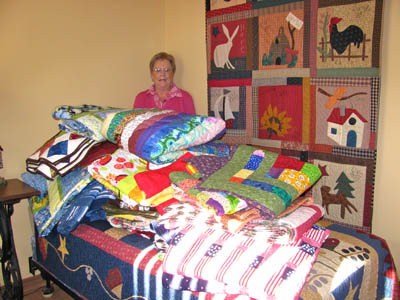 Jo Ann Moore with community quilts.