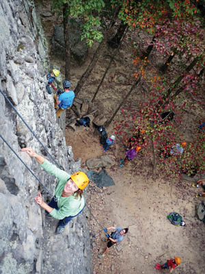 Kelly climbing, assisted by Ben.