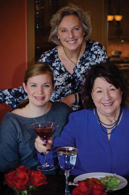 Sarah Knight, Deb Peterson and Estella Tullgren sample the Celebration Champagne Punch.