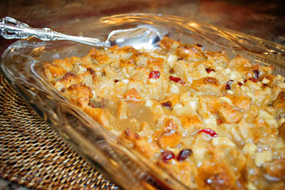 Apple and Cranberry Croissant Bread Pudding with Caramel Drizzle.