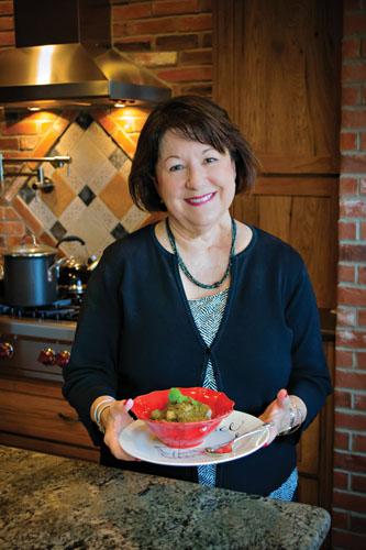 Estella with her Hatch Green Chile Pork Stew.