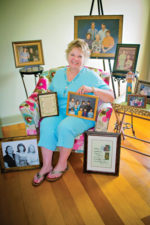 Corrine Hiser surrounded by family photos.